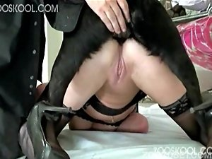 Busty MILF zoophile knows how to please her lovely doggy