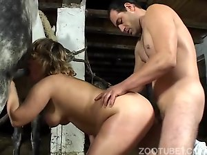 Curly-haired busty jockey gets impaled by farm animal
