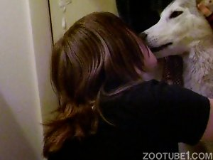 Dirty-minded wife zoofil kisses her dog with passion