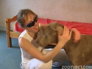 Girl with glasses teaches big dog how to fuck her